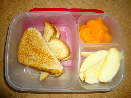 Grilled cheese, oranges and apple slices