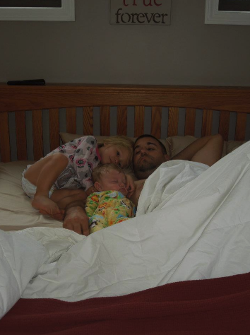 A cuddly morning in Mom and Dad's bed