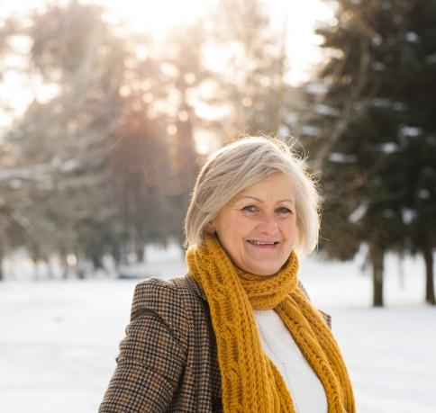 senior-woman-in-winter-nature-going-ice-skating-P38XAJY.jpg