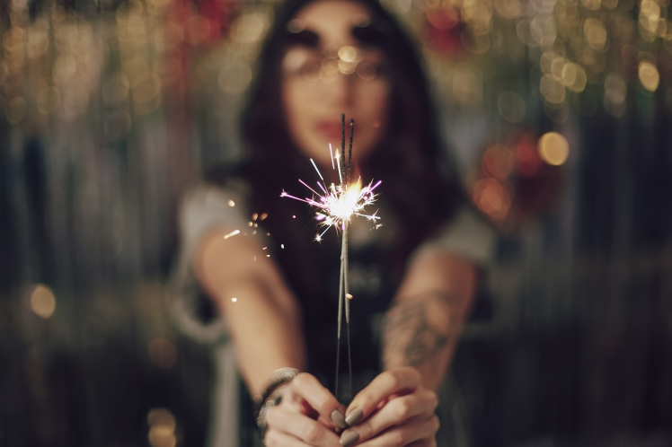 woman-hands-holding-sparklers-PWPNV4T.jpg