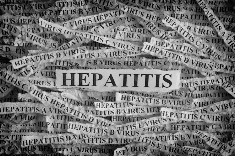 torn-pieces-of-paper-with-the-words-hepatitis-P2W7QRU.jpg