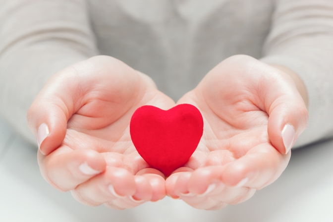 small-red-heart-in-womans-hands-in-a-gesture-of-PEW8YH6.jpg