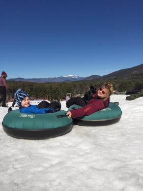 tim and mommy snowtubing grins atop  cranmore 2016.jpg